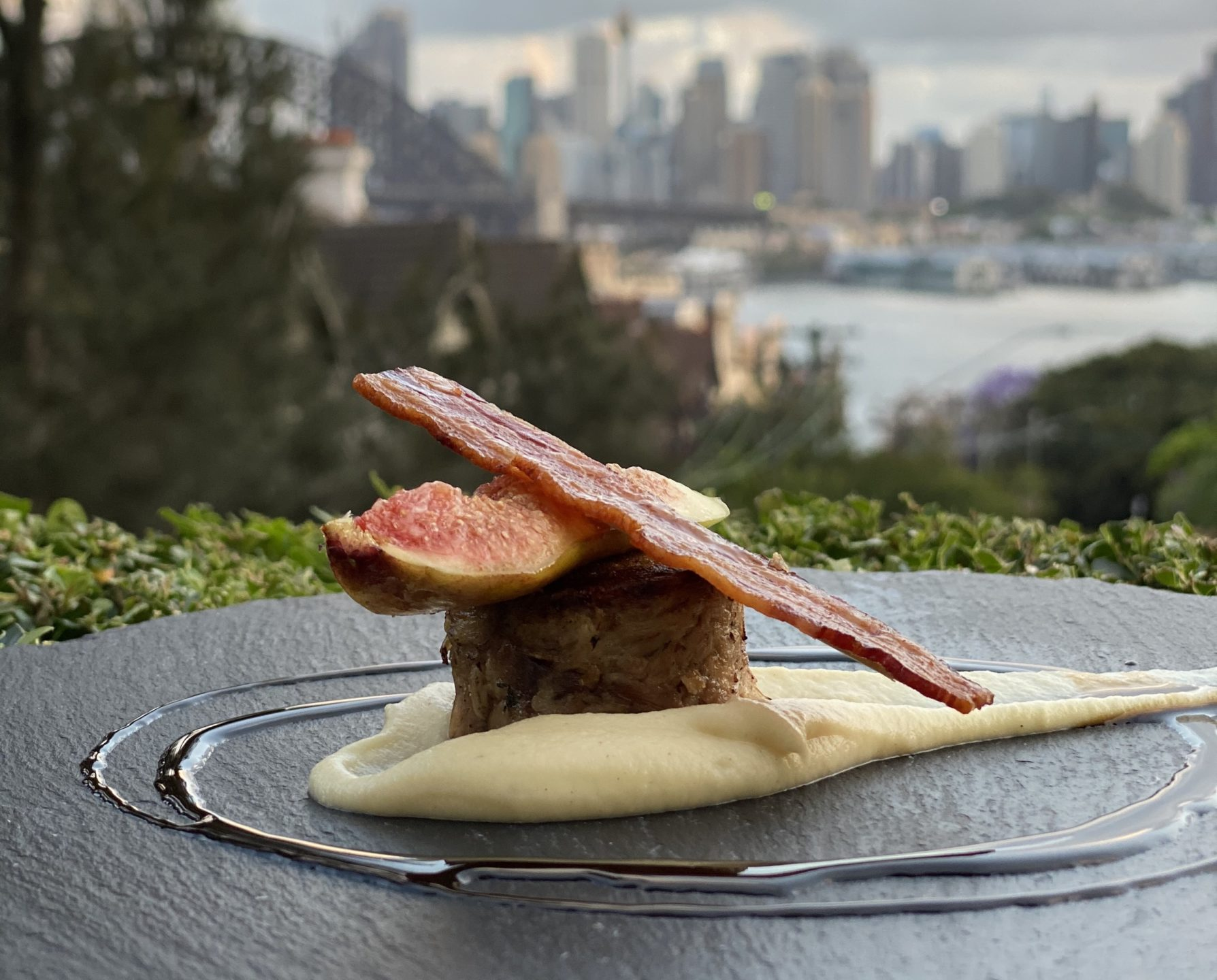 New Year's Eve dinner dish with Sydney Harbour VIews in Background